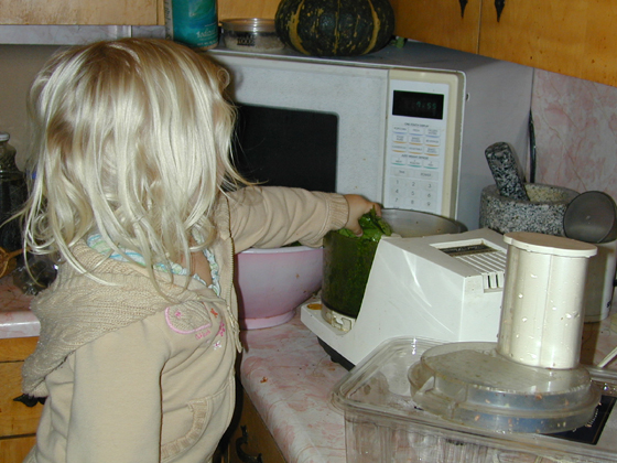Miriam puts spinach into the food processor