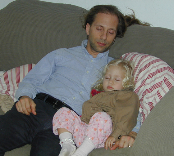 Michael and Miriam sleeping on the couch