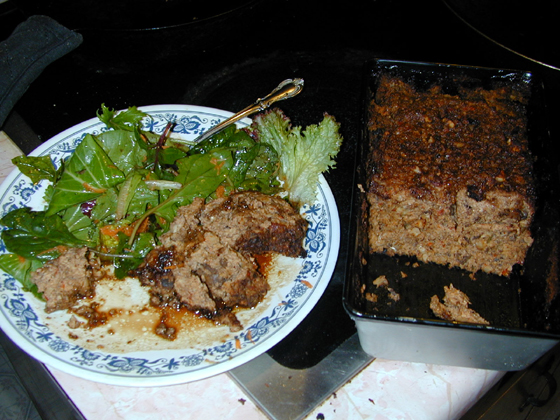 Nutloaf cooked and plated with salad and balsamic vinegrette