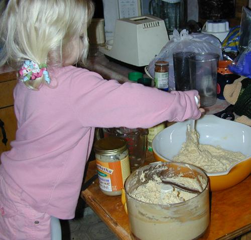 Miriam stirring hummus
