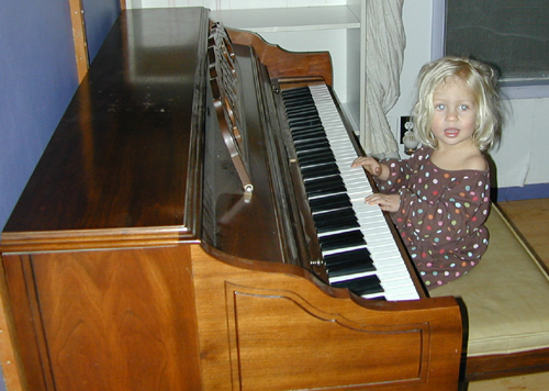 Miriam at her new piano