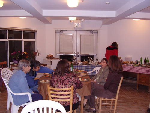 People gathered around the main table