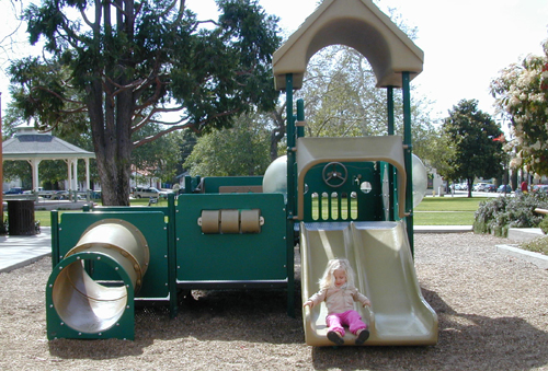 Miriam on the toddler slide at Mitchell Park, SLO