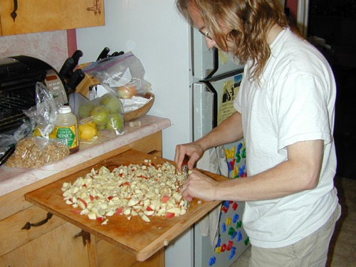 Michael chopping apples for charoset