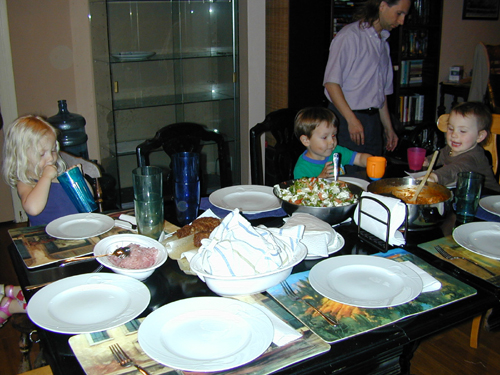 Miriam, Donavan, & Roxie ready to eat, with Michael in the background