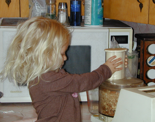 Miriam helps grind almonds for the torte crust