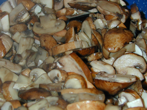 Mushrooms after being sliced and added to the pot