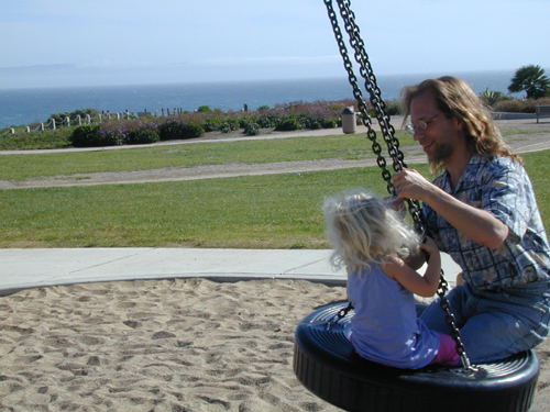 Miriam & Michael on the tire swing at Shell Beach