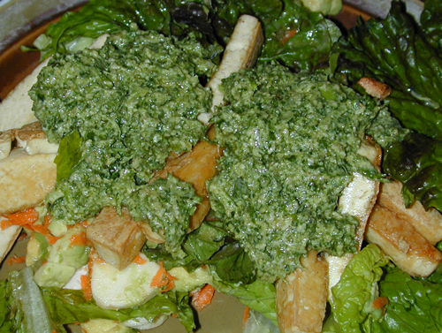 Pesto served over salad and tofu