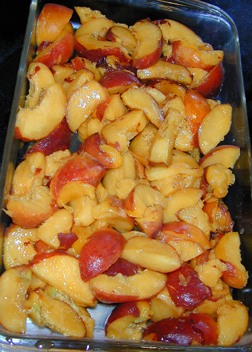 Sliced peaches in a pan