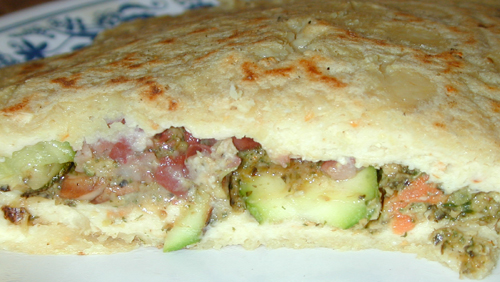 Pupusa stuffed with leftover veggies and burger