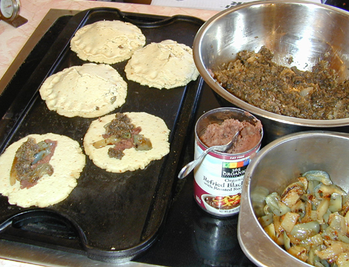 Pupusas cooking on the griddle
