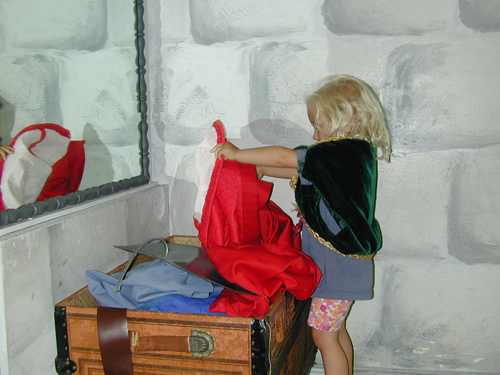 Miriam plays dress-up in the castle room