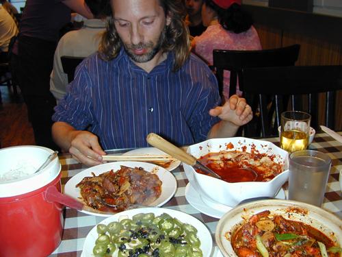 Michael enjoying Xiang's offerings
