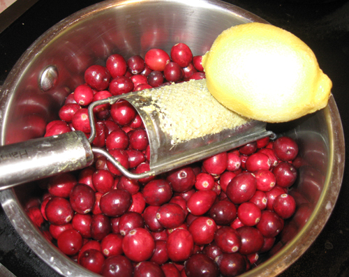 Zesting a lemon over cranberries