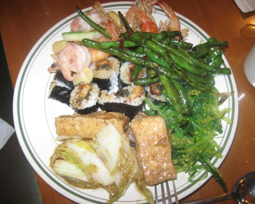Plate of sushi and hot foods