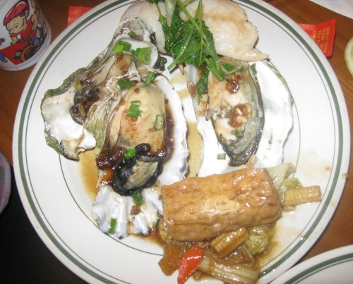 Plate of oysters, fish, and tofu