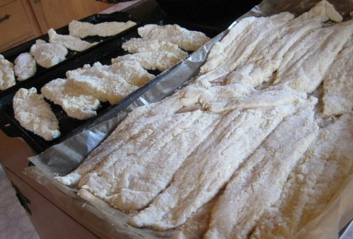 Frozen battered fish, direct from freezer (right) or ready for the oven (left)